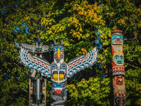Colorful indian totems in stanley park vancouver canada summer