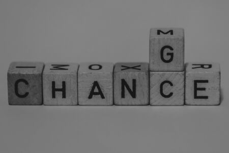 macro shot of wooden cubes on a table showing the word CHANGE or CHANCE, Business Imagens