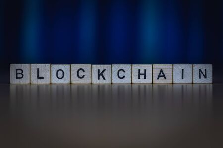 macro shot of wooden cubes on a table showing the word BLOCKCHAIN, Business Banque d'images - 131938550