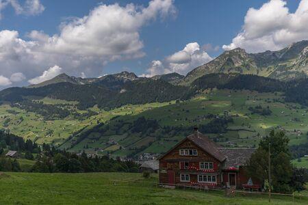 a farm between the beautiful swiss alps near toggenburg, summer Stock Photo - 128611645