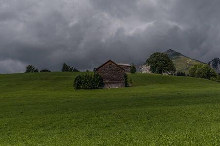 a farm between the beautiful swiss alps near toggenburg, summer Stock Photo - 128611649