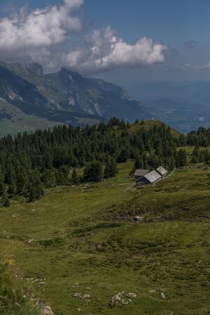a farm between the beautiful swiss alps near toggenburg, summer Stock Photo - 128611603