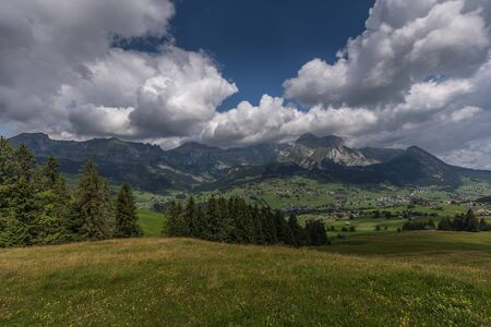 Hiking through swiss alps on a sunny day with blue sky near toggenburg, gamsalp Stock Photo - 128611578