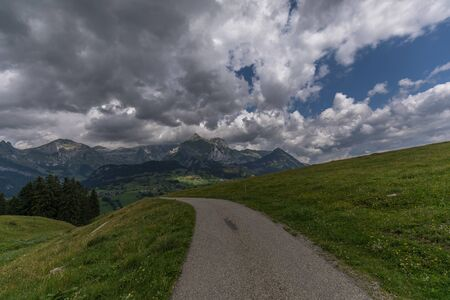 Hiking through swiss alps on a sunny day with blue sky near toggenburg, gamsalp Stock Photo - 128611586