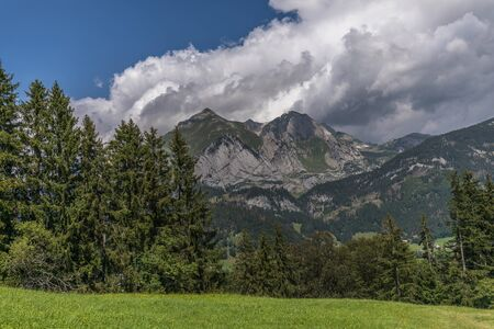 Hiking through swiss alps on a sunny day with blue sky near toggenburg, gamsalp Stock Photo - 128611589