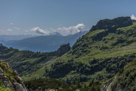 Hiking through swiss alps on a sunny day with blue sky near toggenburg, gamsalp Stock Photo - 128611550