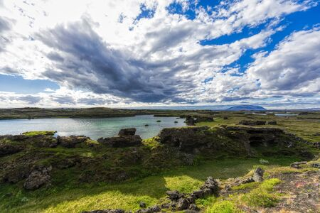 panorama of myvatn lake with blue sky and clouds on iceland, summer