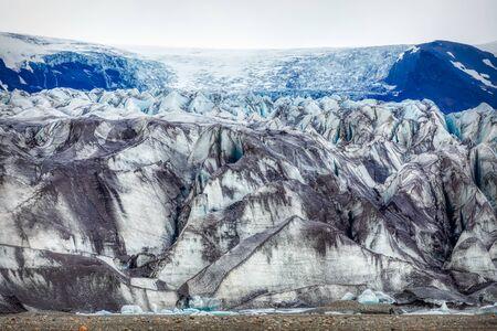 beautiful blue shining glacier structure at the lagoon fjallsarlon on iceland, summer 写真素材