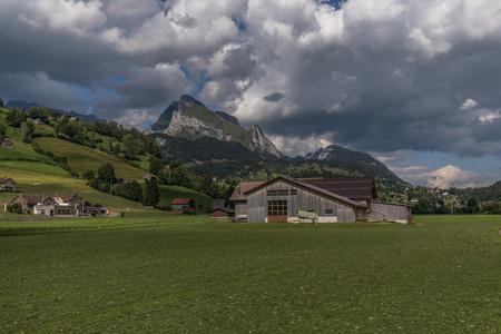 a farm between the beautiful swiss alps near toggenburg, summer Stock Photo - 128621838