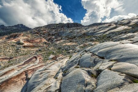 heavy stones on rhone glacier between swiss alps, switzerland 版權商用圖片