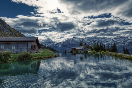 Haerzli lake on mount Brunni at Engelberg in the Swiss alps in summer Imagens