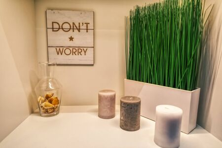 beautiful decoration with candles, green grass and a dont worry sign, garden