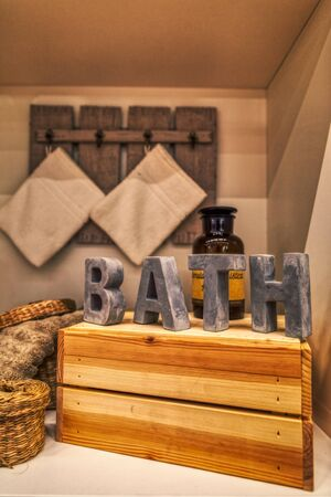 beautiful decoration with bathing accessories and wooden letters, bathroom