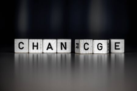the words change an chance as Concept on wooden cubes, business