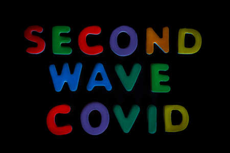 Words, Covid second wave, written in colorful letters on black background