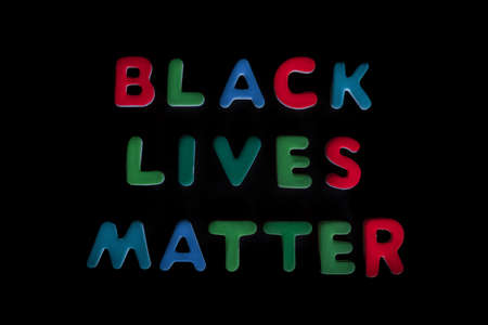 Words, black lives matter, written in colorful letters on black background