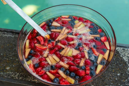 colorful fruit salad with strawberries, blueberries, mango and pineapple, food