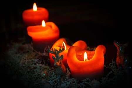 Christmas candles in advent with snowy decor
