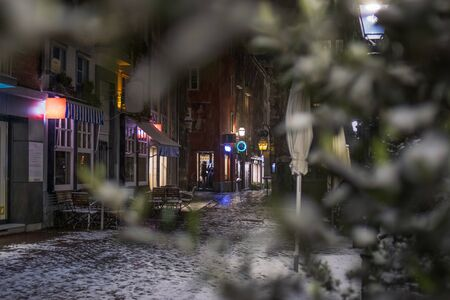 Snowy empty street at night in Aachen, Germany Banque d'images