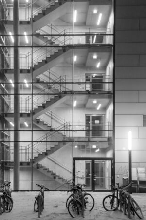 Stairwells behind the transparent glass of the building in winter. Background image. Banque d'images