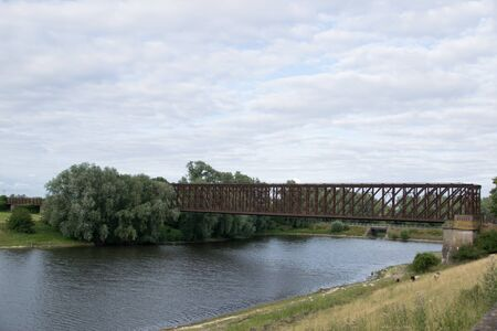 Old Train Steel Bridge over river at sunset Banque d'images