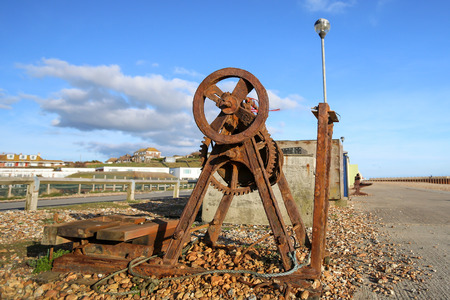 winch: Old rusty winch at the seafront in Seaford, England.Photo taken on April 04, 2015