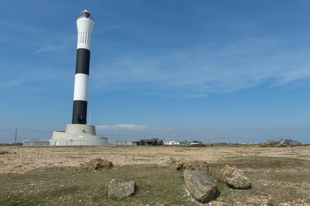 dungeness: New black and white Dungeness Lighthouse at Dungeness, Romney Marsh, Kent EnglandPhoto taken on April 07, 2015 Stock Photo