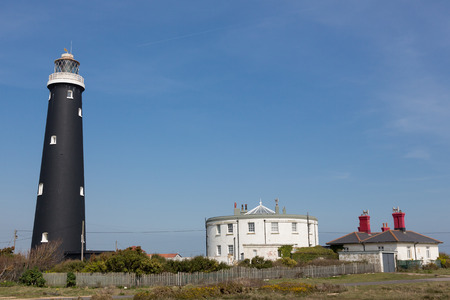 dungeness: Old Dungeness Lighthouse and houses at  Dungeness, Romney Marsh, Kent EnglandPhoto taken on April 07, 2015