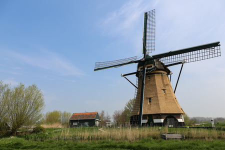 bridge over water: Dutch windmill with a bridge over water and a path in a dutch landscape
