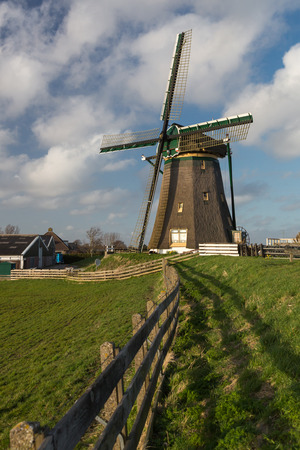 lisse: Traditional Dutch landscape with  windmill at the Rooversbroekdijk, Lisse, Holland. Stock Photo