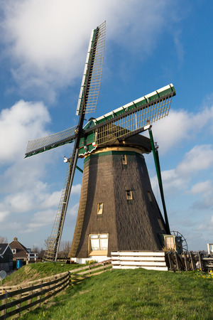 holland landscape: Traditional Dutch landscape with  windmill at the Rooversbroekdijk, Lisse, Holland. Stock Photo