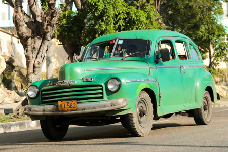 old mercury: Havana, Cuba - January 31, 2014 - Green classic taxi car in Havana, cuba on the road Photo taken
