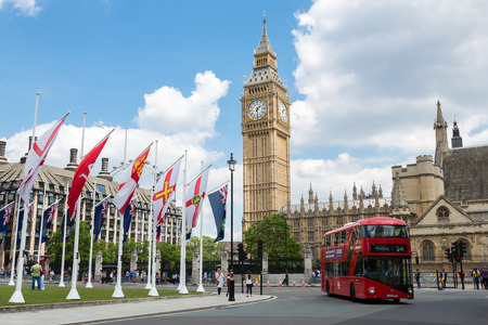 doubledecker: London, England - June 1, 2014 - Big Ben Clock Tower and Westminster abbey with red double-decker bus