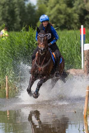 eventing: Leidschemdam, The Netherlands - June 29, 2014 - cross  rider competing at the Vlietland event in Leidschendam, The Neterlands Photo taken on: juni 29st, 2014