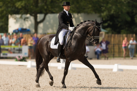glock: Hoofddorp, The Netherlands - August, 2014 - Edward Gal with his horse Glock Editorial