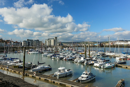 motorboats: Newhaven, England - April, 2015 - Newhaven marina  with small motorboats ans sailboats at a low tide in springPhoto taken on April 04, 2015 Editorial