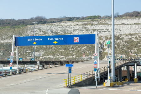dover: Dover, England - April 7, 2015 - Road signs at Dover port indicating the exit and speedlimitPhoto taken on April 07, 2015 Editorial