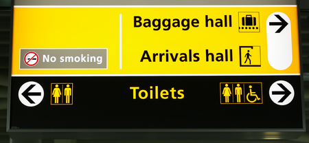 Airport baggage hall and arrivals hall with toilets sign Photo taken on: September 11th, 2015