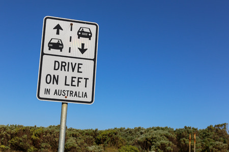 great danger: Drive on left in Australia sign against a clear blue sky on the Great Ocean Road near Melbourne
