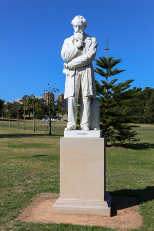 Live size marble statue of Charles Dickens in Centennial park Sydney. This is one of three statues in the world of the English novelist and social commentator.