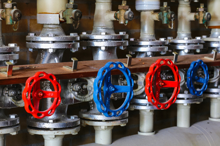 Industrial red and blue valves and pipelines