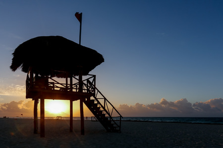 Lifeguard tower silhouette during runrise at the beach of Playa del Carmen, Quintana Roo, Mexico
