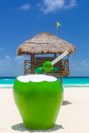 Lifeguard tower and cocktail at the beach in summer, concept of alcohol and safety. Stockfoto