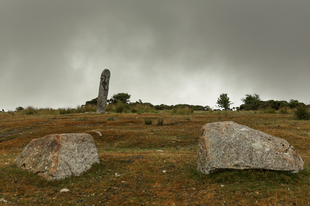 Old Tom or the Long Stone on a cloudy and mistic morning in Cornwall near Bodmin in England