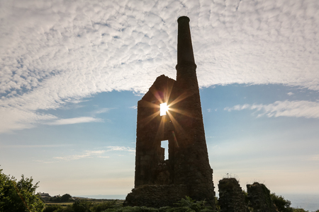 The ruins of Carn Galver Mine on the coast at during sunset near Penwith Cornwall England. The engine house was used during tin mining and is now owned by the National Trust.