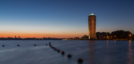 Sunset over the Westeinderplassen lake with a water Tower in Holland, The Netherlands Banco de Imagens