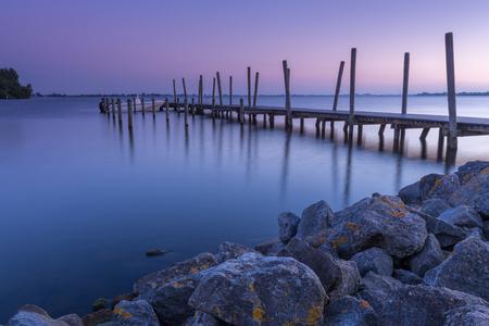 Sunset at the Westeinderplassen lake pier, Holland Banco de Imagens
