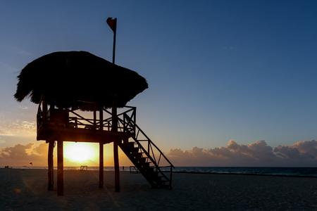 Lifeguard tower silhouette during runrise  at the beach of Playa del Carmen, Quintana Roo, Mexico Banco de Imagens