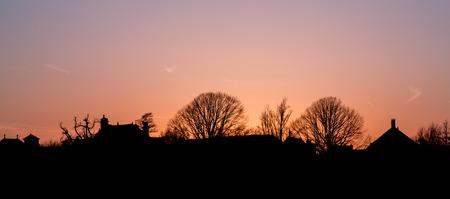 Silhouetted village skyline at dusk near Zaanse Schans The NetherlandsPhoto duties on April 16, 2018 Banco de Imagens
