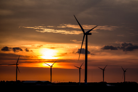 Wind Energy. Wind Turbines or winmills Silhouette during Sunset in Flevoland, The Netherlands. Photo taken on April 23, 2018